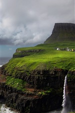Preview iPhone wallpaper Faroe Islands, waterfall, Atlantic, mountain, rocks, storm, clouds