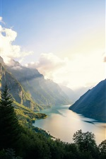 Preview iPhone wallpaper Klontalersee, mountains, trees, lake, clouds, sun rays, Switzerland