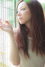 Preview iPhone wallpaper Long hair asian girl, light, fence