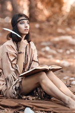 Preview iPhone wallpaper Long hair girl in the forest, reading book