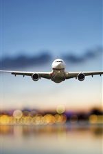 Preview iPhone wallpaper Airplane, passenger airliner, flight, sea, lights, airport, evening