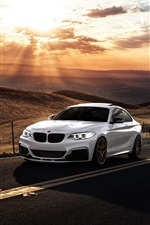 Preview iPhone wallpaper BMW M235i white car, sunset, clouds, road
