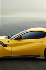 Preview iPhone wallpaper Ferrari F12 yellow supercar side view