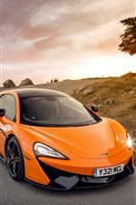 McLaren 570S orange supercar, road