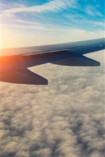Preview iPhone wallpaper Passenger airplane, aircraft wing, sun, sky, clouds