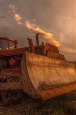 Bulldozers, graders, equipment, farmland, dusk