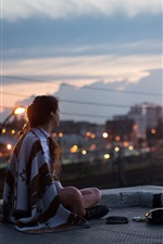 Preview iPhone wallpaper Girl, night, roof, sits, city, street, lights