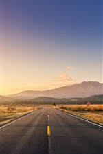 Preview iPhone wallpaper Road, mountains, grass, sunset