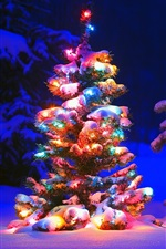 Preview iPhone wallpaper Snow and lights on tree in the forest, Christmas
