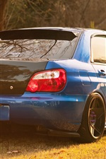 Preview iPhone wallpaper Subaru Impreza blue car back view, grass, sunlight