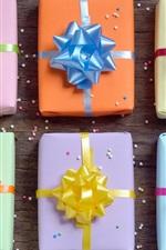 Preview iPhone wallpaper Gift boxes, wooden, colorful bows