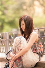Preview iPhone wallpaper Sadness Asian girl, sit at street