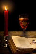 Tranquillity dark, candle, books, glass, apple