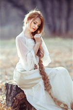Preview iPhone wallpaper White dress girl, sitting on stump, long blonde hair