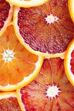 Preview iPhone wallpaper Fruit slices, oranges, grapefruit, juice, red and yellow