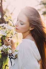 Preview iPhone wallpaper Girl hair in the wind, sun rays, spring, white flowers