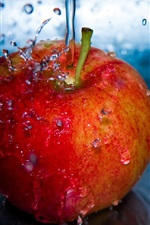 Preview iPhone wallpaper Red apple, water drops, splash
