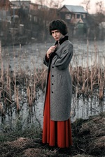 Preview iPhone wallpaper Short hair girl, coat, village, swamp