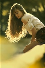 Preview iPhone wallpaper Young girl in sunshine