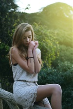 Preview iPhone wallpaper Beautiful blonde girl in dream, sitting at fence, morning