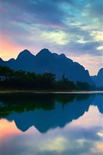 Preview iPhone wallpaper China, Yangshuo, Guangxi, Lijiang river, mountains, water reflection, sunset