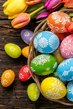 Preview iPhone wallpaper Easter eggs, colorful, tulips, wood, basket