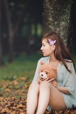Preview iPhone wallpaper Long hair asian girl, teddy bear, leaves, autumn