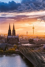 Preview iPhone wallpaper Beautiful Cologne city, Germany, sunset, bridge, river, houses, sky, clouds