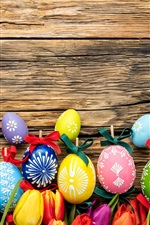 Preview iPhone wallpaper Happy Easter, colorful eggs, wood board, tulips flowers