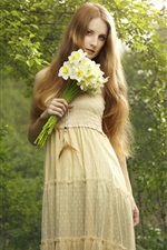 Preview iPhone wallpaper Beautiful blonde girl holding a bouquet daffodils flowers