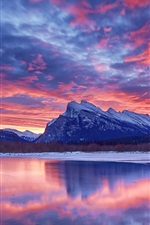 Preview iPhone wallpaper Winter, snow, lake, sky, clouds, sunset, glow, mountain