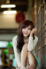 Preview iPhone wallpaper Asian girl smile, posture, house, bokeh