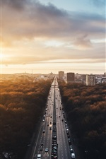 Preview iPhone wallpaper Berlin, Germany, city landscape, road, traffic, buildings, trees, sunset
