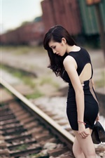Black dress Asian girl, railway