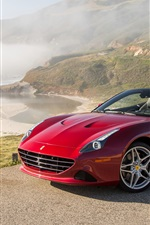 Ferrari California red supercar, coast, mountains