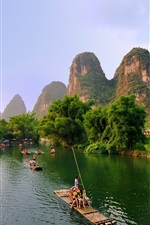 Preview iPhone wallpaper Guilin, Yangshuo beautiful landscape, mountains, trees, river, bamboo raft, China