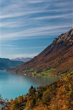 Preview iPhone wallpaper Lake, mountains, village, slope, water, trees, clouds