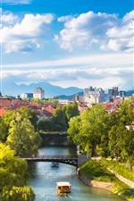 Preview iPhone wallpaper Beautiful Ljubljana city in Slovenia, houses, river, trees, mountains, clouds