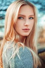 Preview iPhone wallpaper Blonde girl look back, blue eyes, bokeh