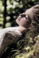 Preview iPhone wallpaper Blonde girl sleeping in forest, relaxation