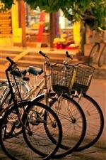 Preview iPhone wallpaper City, night, street, bikes, sidewalk