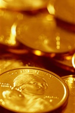 Preview iPhone wallpaper Gold coins close-up, currency