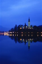 Preview iPhone wallpaper Lake Bled in Slovenia, night, lights, water reflection