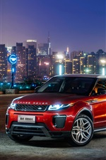Land Rover Range Rover Evoque red SUV at city night
