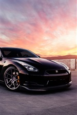 Preview iPhone wallpaper Nissan GT-R black car at sunset