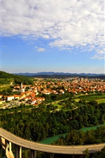 Preview iPhone wallpaper Nova Gorica, Slovenia, city view, road, river, houses, trees, clouds
