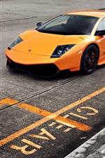Orange Lamborghini Murcielago LP670-4 SV supercar at road