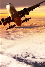 Preview iPhone wallpaper Passenger plane flying on clouds top