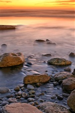 Preview iPhone wallpaper Sunset coast, stones, sea, red sky