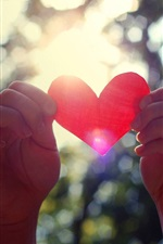 Preview iPhone wallpaper Valentine's Day, love heart in hands, sun rays